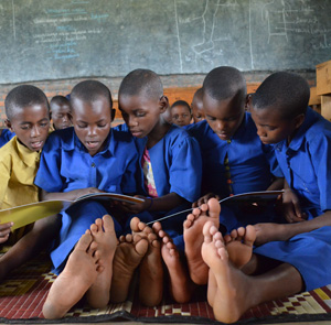 Children in Rwanda reading their first book