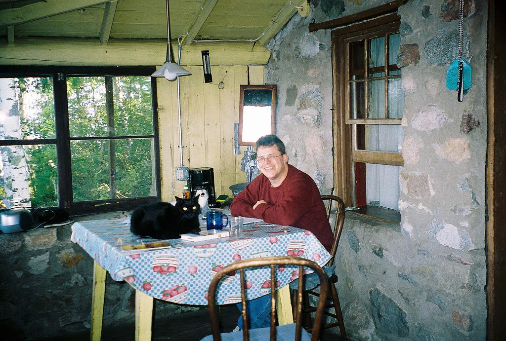 Kurtis with his cat, Torii